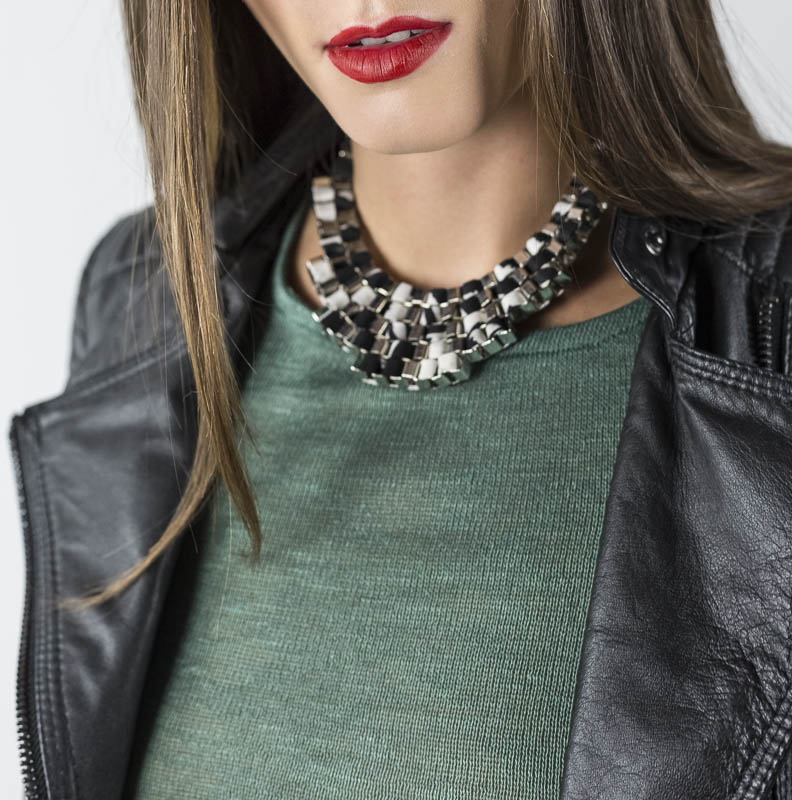 woman in green shirt with fabric chain necklace