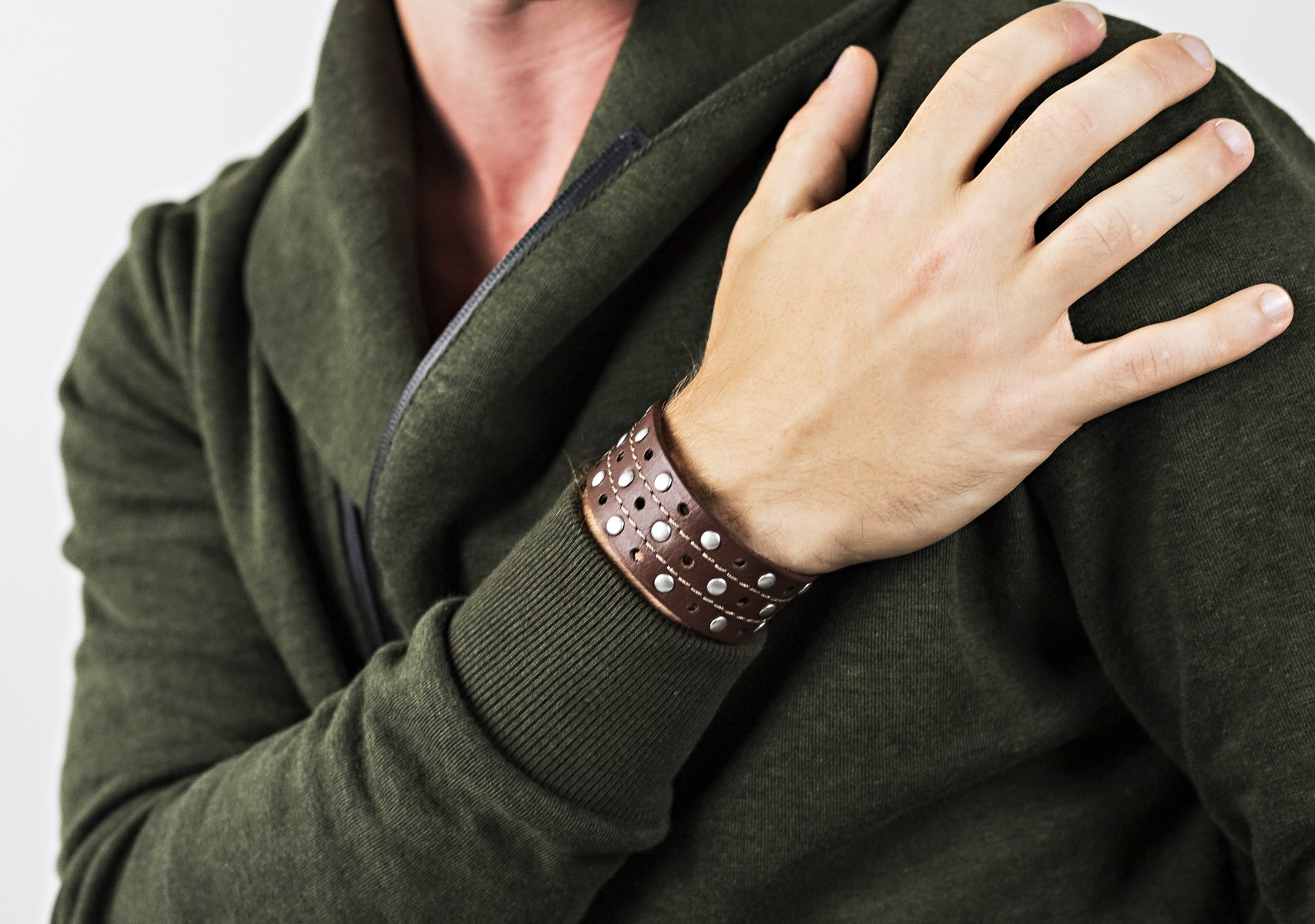 Faux leather bracelet with silver studs